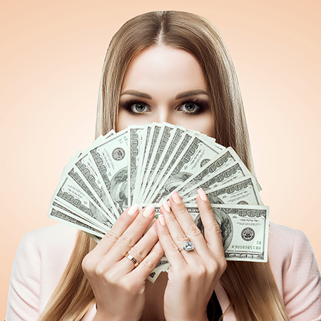 Woman with a fan of money in her hands. Beauty portrait of young girl covers her face with money. Bills of 100 USD. Studio light background. Isolated on brown background. Makeup bright gold